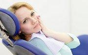 Почему после пломбировки болит зуб